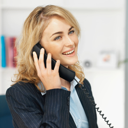 Side view of businesswoman talking on telephone